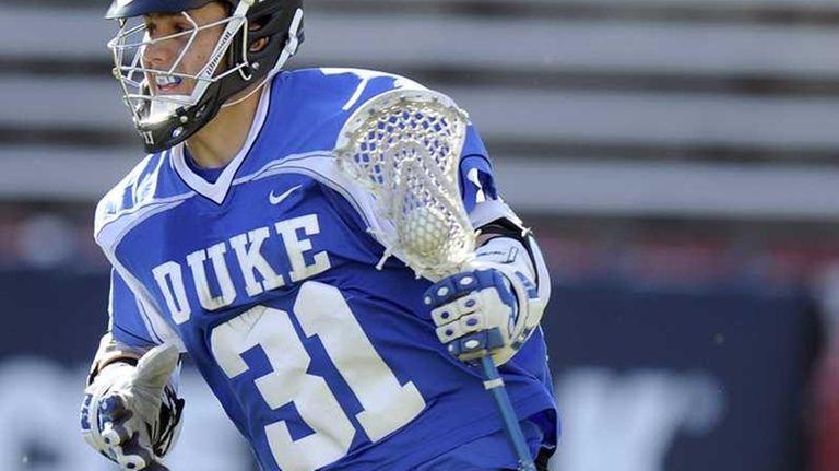 Jordan Wolf of the Duke Blue Devils handles