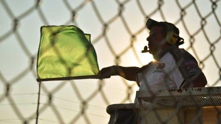 A flagman waves the green flag at Riverhead