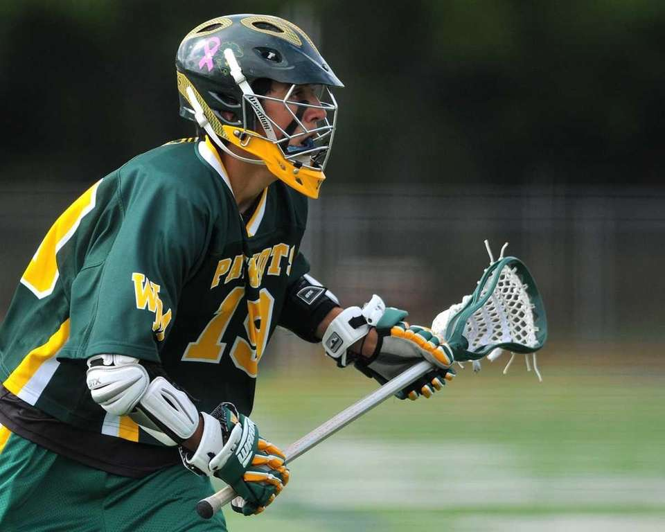 Ward Melville's Michael Rastivo carries inside Smithtown West
