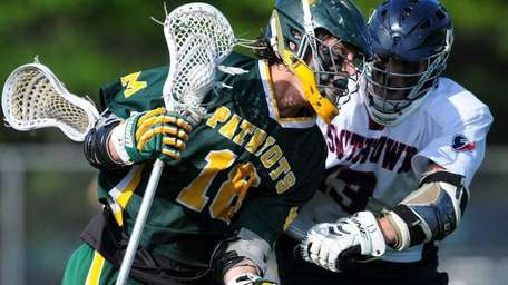 Ward Melville's Jack Bruckner, left, gets pressured by