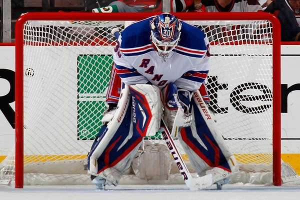 Henrik Lundqvist looks on against the New Jersey
