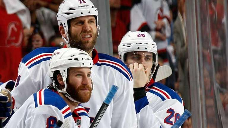 Brandon Prust #8, Mike Rupp #71, and Chris