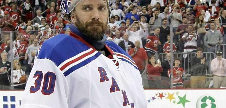 Rangers goalie Henrik Lundqvist skates off after the