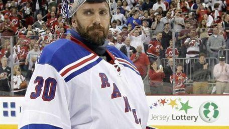 Rangers goalie Henrik Lundqvist skates off after the