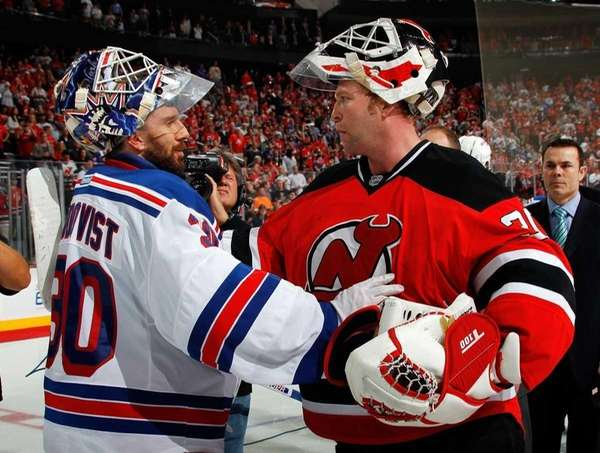 Martin Brodeur of the New Jersey Devils shakes