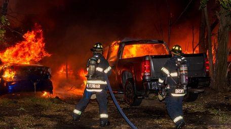 A fire damaged 25 vehicles at an auto