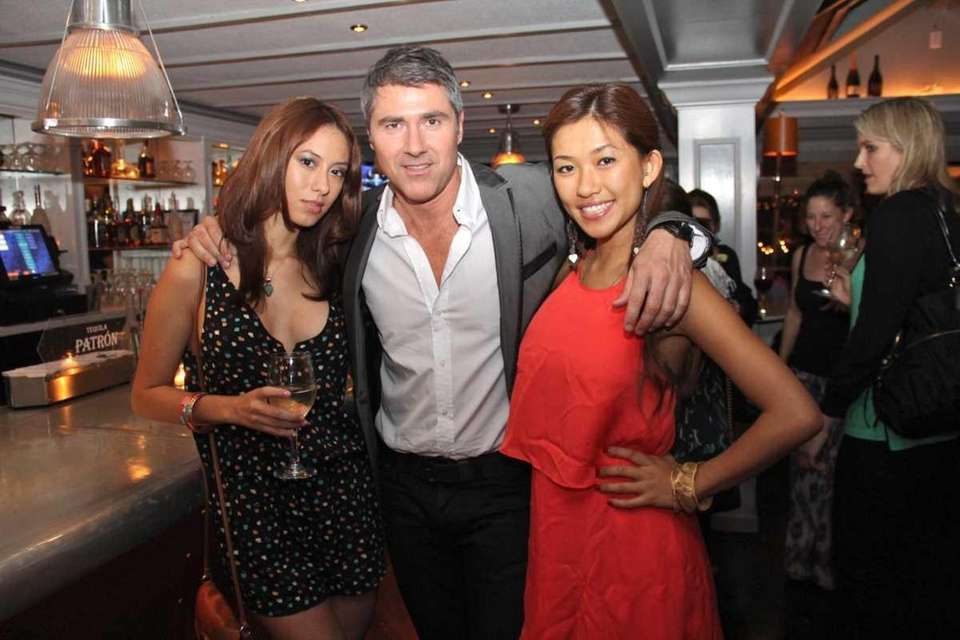 Corey Lane and Jocelyn Lam attend the opening