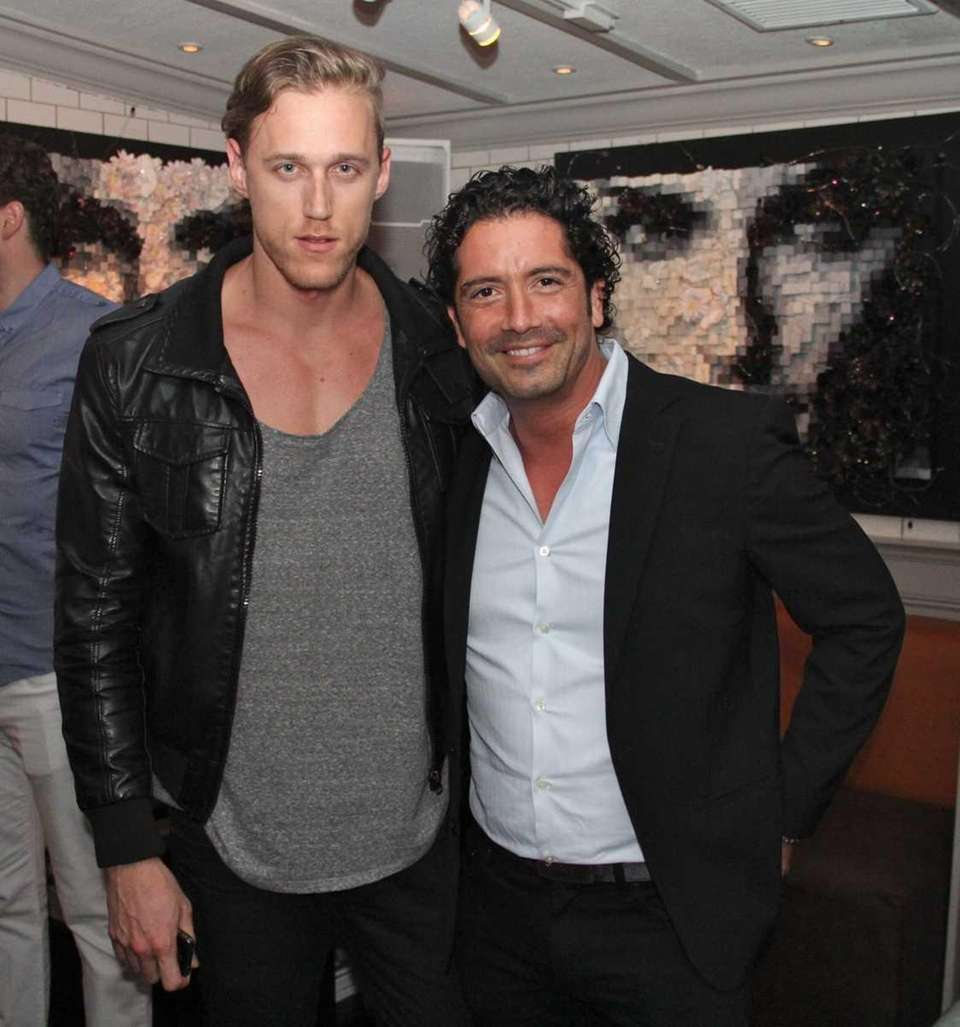 Jaret Bell and Roberto Buchello attend the opening