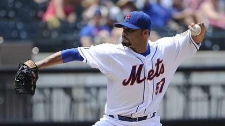 Mets pitcher Johan Santana delivers in the second