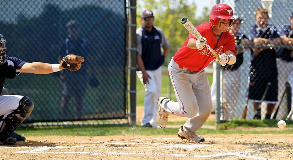 Smithtown East's Chris Rubin lays down a bunt
