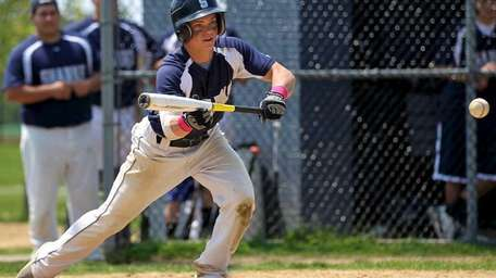 Eastport-South Manor's Mike Griffiths bunts for a hit