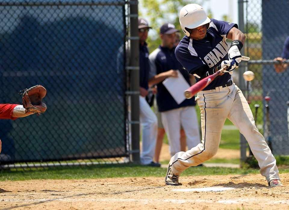Eastport-South Manor's Andrew Karkota strokes a double into