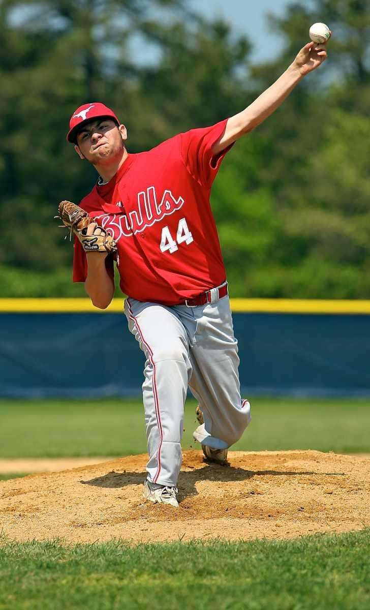 Smithtown East's starting pitcher Justin Cusano delivers against