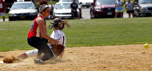 Bay Shore's Courtney Syrett (1) is safe at