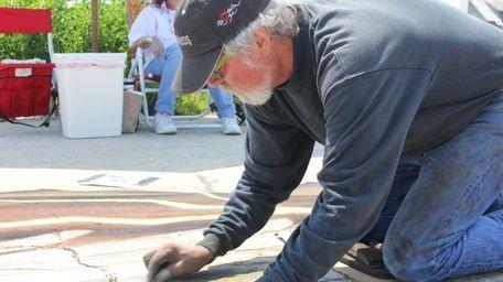 Rod Tryon, 58, of Cutchogue creates a chalk
