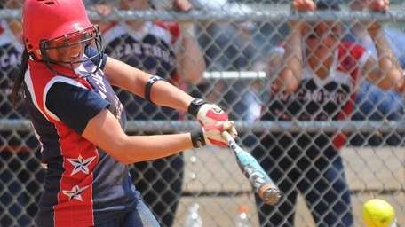 MacArthur pitcher #2 Kristen Brown hits a two-run