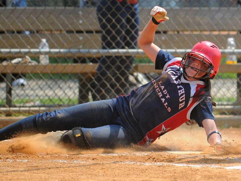 MacArthur pitcher #2 Kristen Brown slides home safely