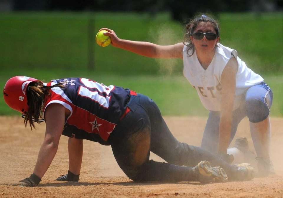 East Meadow shortstop #11 Tianna LaRosa, right, tries