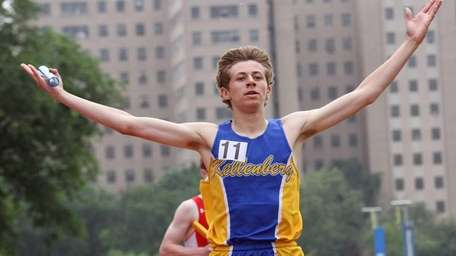 Kellenberg's anchor leg, Dylan Murphy, reacts after crossing
