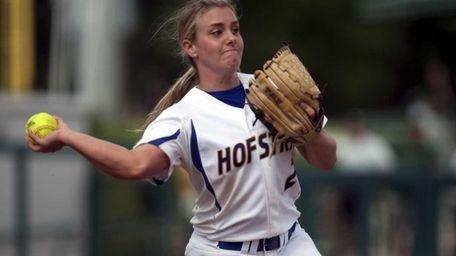 Starting pitcher Olivia Galati throws to first base