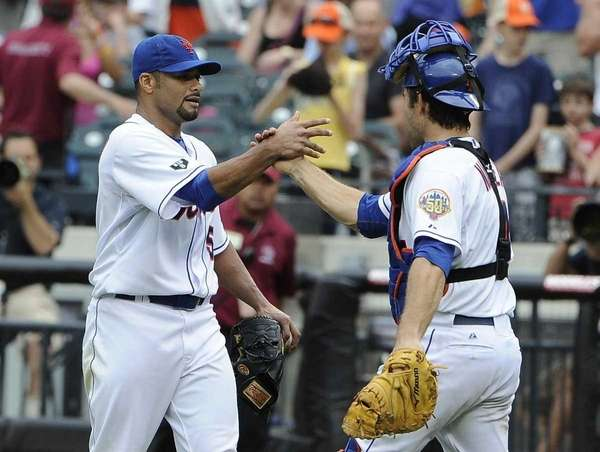 Mets pitcher Johan Santana is congratulated by catcher