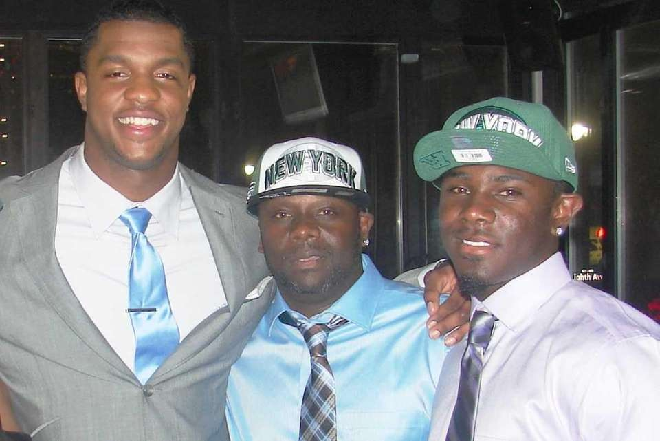 Quinton Coples with his godfather, Christopher Bradshaw, and
