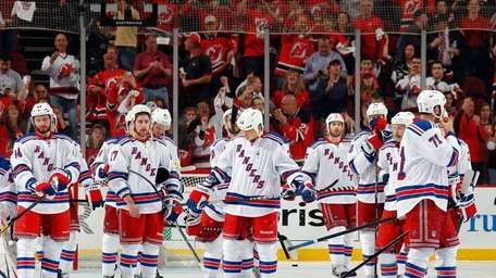 The Rangers look on after losing Game 6