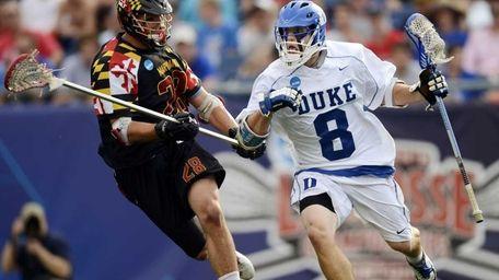 Duke's Josh Dionne, right, runs with the ball