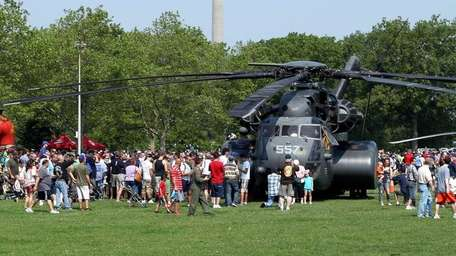 The crowd at Eisenhower Park tours the MH-53E