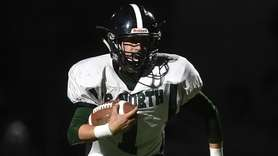 Tim McGrath, Valley Stream North quarterback, scrambles seven