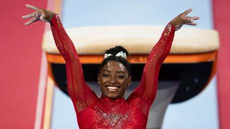 Simone Biles of USA reacts in the Vault