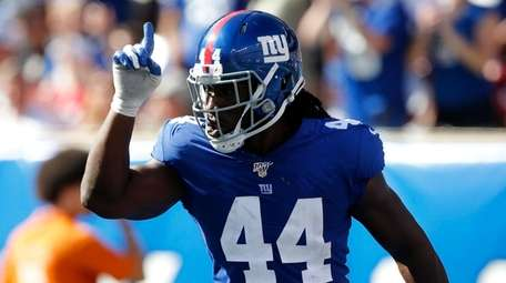 Markus Golden of the Giants reacts during a