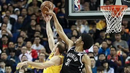 Jarrett Allen of the Nets handles the ball