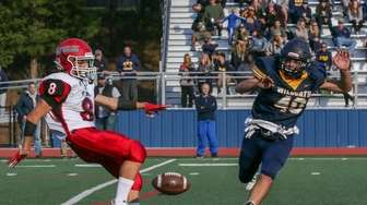 Mount Sinai's Matthew LoMonaco #8 punts as Shoreham-Wading