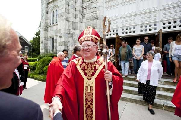 Bishop William Murphy greets well-wishers at the Basilica