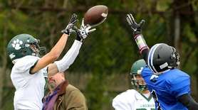 Lindenhurst WR Andrew Iula makes the leaping grab
