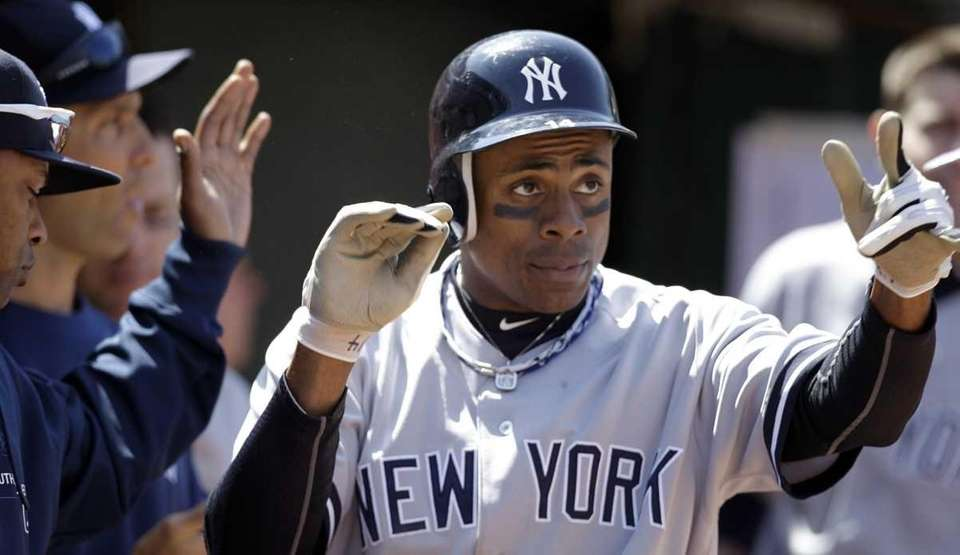 New York Yankees' Curtis Granderson is congratulated after
