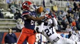 New Hampshire Wildcats cornerback Derek Thompson breaks up