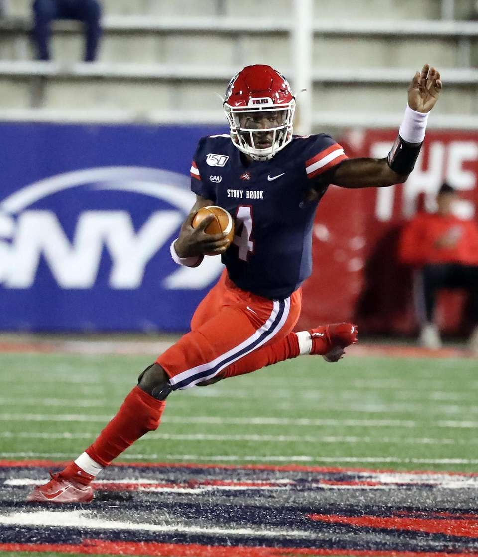Stony Brook Seawolves quarterback Tyquell Fields (4) runs