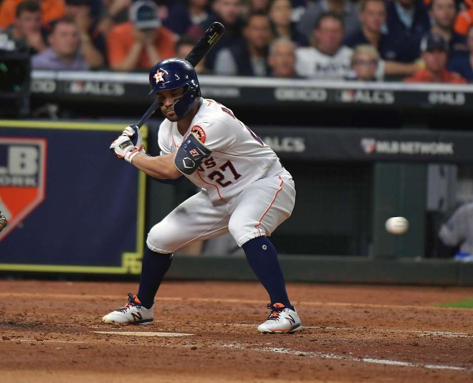 Houston Astros second baseman Jose Altuve (27) reacts