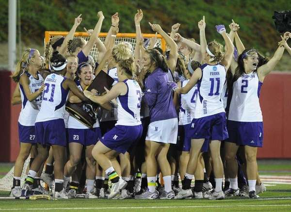 Northwestern celebrates their 8-6 win over Syracuse for