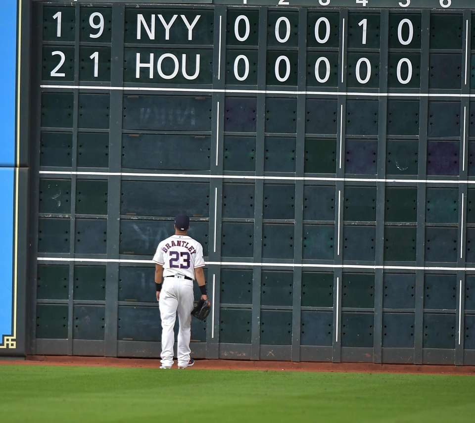 Houston Astros left fielder Michael Brantley (23) watches