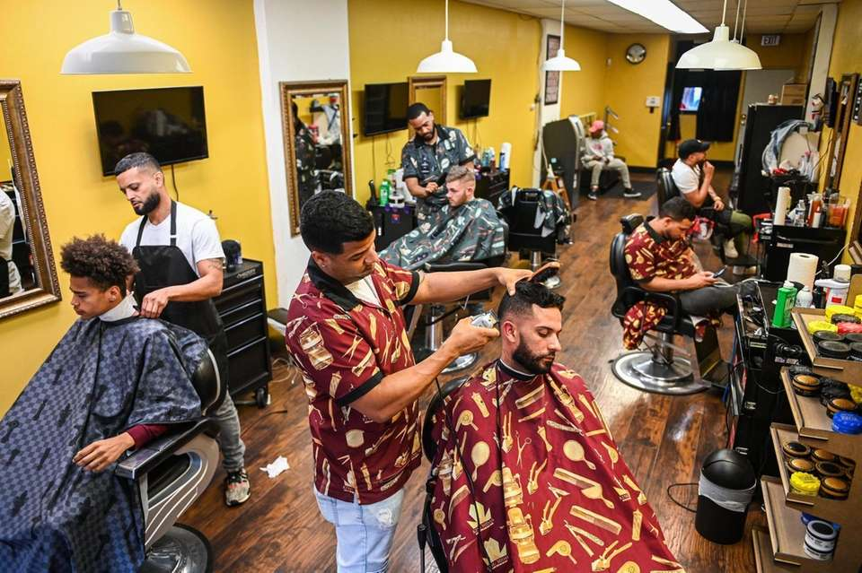 Owner of Evolution Barbershop in downtown Patchogue, Joe