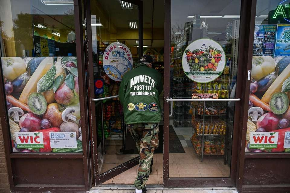 A man walks into the Bravo supermarket in