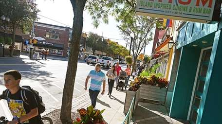 People stroll downtown Patchogue on Saturday. Downtown Patchogue