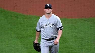 Yankees relief pitcher Zack Britton (53) walks off