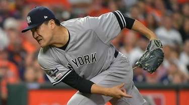 Yankees starting pitcher Masahiro Tanaka (19) pitches in