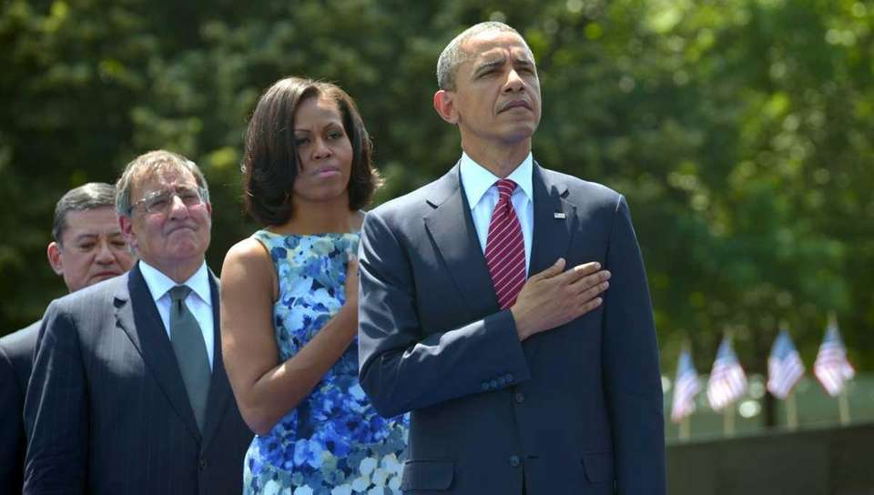President Barack Obama, his wife Michelle, Defense Secretary