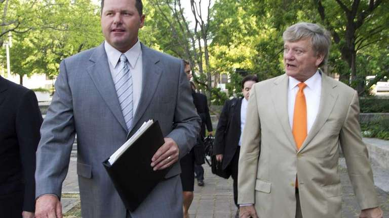 Roger Clemens and his attorney, Rusty Hardin, arrive