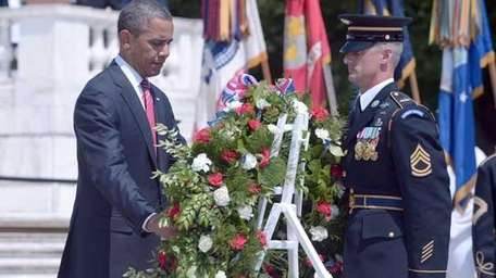 President Obama places a wreath at the Tomb